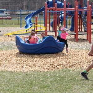 Boyne-Elementary-slide-merry-go-round